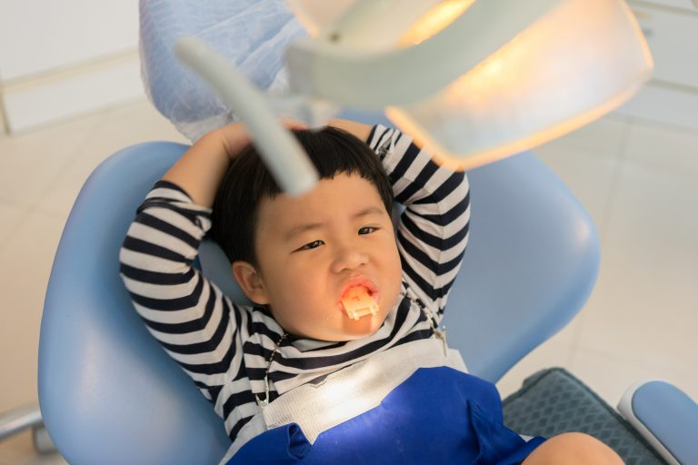 A Boy Teeth Whitening And Fluoride Treatment